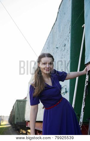Woman In Lilac Dress At Train Stairs