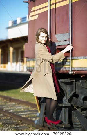 Woman In Coat And Wagon At Station
