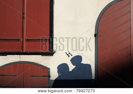 Shadow Of A Pair Of Lovers On A Wall Of An Old House