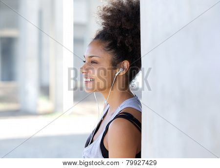 Attractive Young Woman Smiling With Earphones