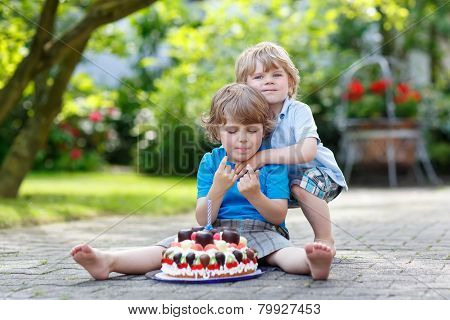 Two Little Children Having Fun Together With Big Birthday Cake