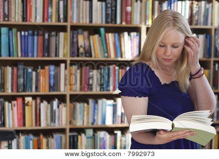 Blonde Bookreader In Study