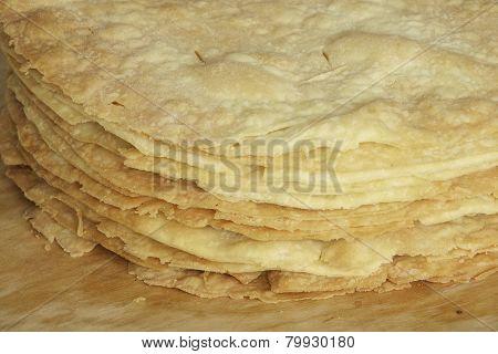 Freshly baked homemade shortcakes for Napoleon cake on the wooden board.