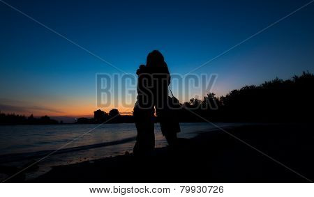 Silhouette of Lovers hug on the Beach