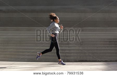 Young Woman Running By Stairs