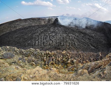 Smoking volcanic pinnacle close to Erta Ale volcano, Ethiopia