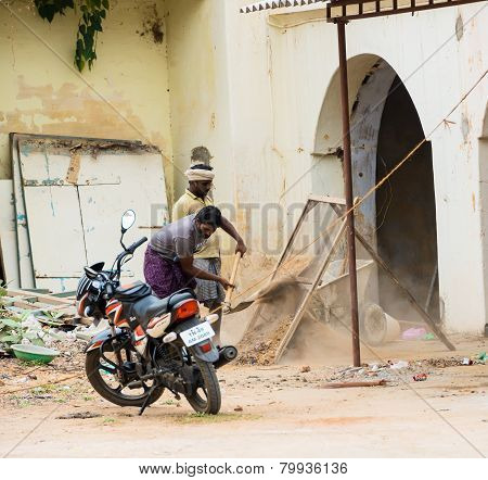 Thanjavour, India - February 14: An Unidentified Indian Man Sifts Sand. India, Tamil Nadu, Thanjavou
