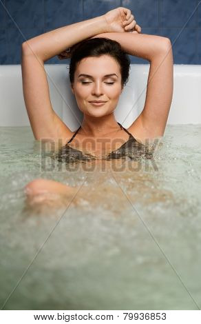 Woman having procedure in a  bathtub