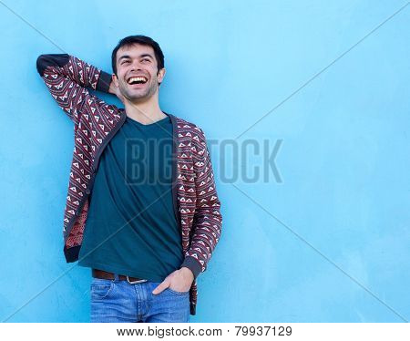 Happy Guy Laughing Against Blue Background