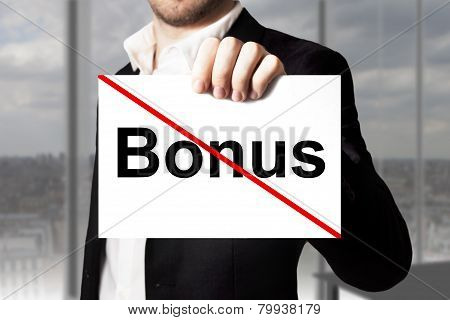 Businessman Holding Sign Bonus Crossed Out