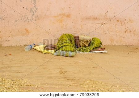 Thanjavour, India - February 13: An Unidentified Indian Person In National Dress Lying Outdoor.  Ind