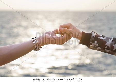 Young Couple In Love  Holding Hands Looking In The Sunset