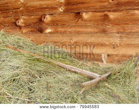 Wooden rake in the hay
