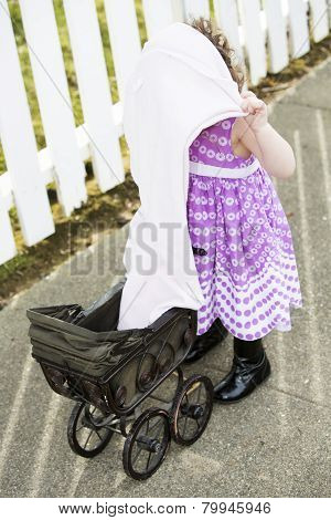 Little Girl With Pram And Blanket Over Head