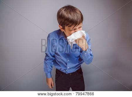 teenager boy 10 years of European appearance sick sneezing in