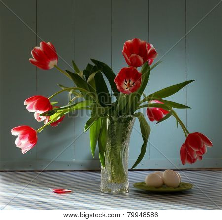 Red Tulips In Crystal Vase With Eggs