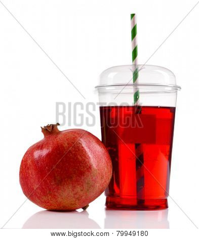 Pomegranate juice in fast food closed cup with tube and garnet isolated on white
