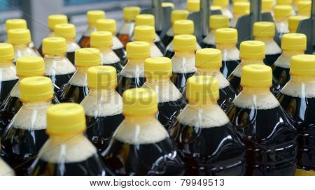 drink bottled, production detail. yellow caps