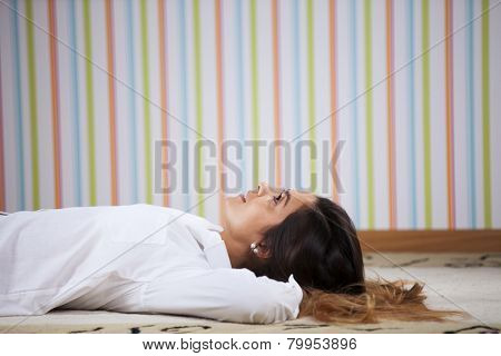 Woman lying in the carpet