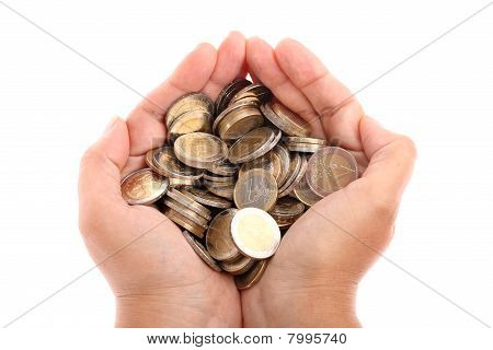 Cupped hands holding euro coins isolated on white
