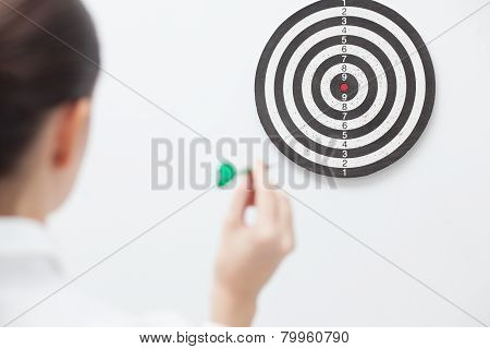 Businesswoman Trying Hit Bullseye