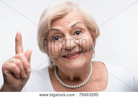 Elderly lady is shaking her finger