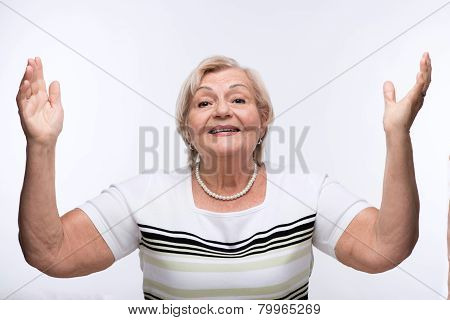 Elderly lady raising hands