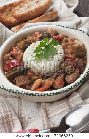 Pork and okra gumbo, cajun style stew served with cooked rice