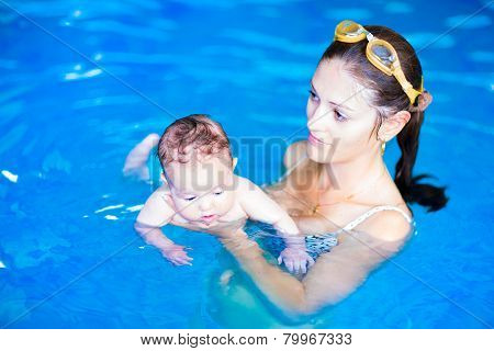 Mother And Baby Girl In Swimming Pool