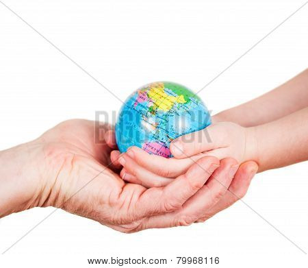 Hands of a child and a man holding globe