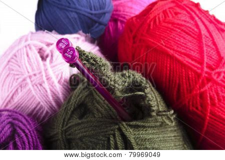 Knitting Needles And Balls Of Wool