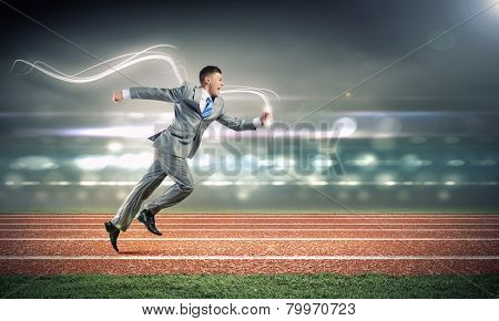 Cheerful young businessman running in a hurry