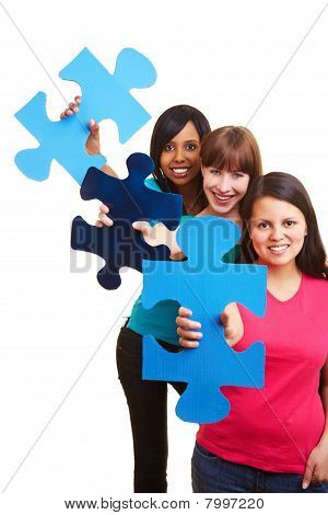 Three Woman Showing Big Jigsaw Pieces