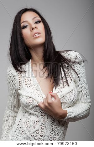 Attractive Brunette Girl In White Cardigan
