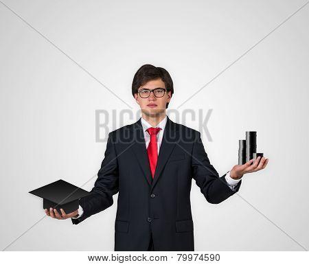 Businessman Holding Bachelor Hat