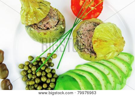 meat meal: round zucchini filled with mince meat over white dish
