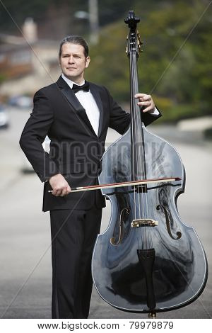 Man Playing The Double Bass In The Street