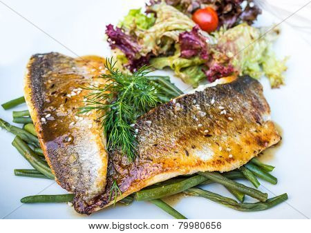 grilled salmon and tomato - french cuisine dish with tomato and salmon