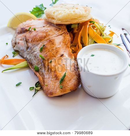 grilled salmon and lemon - french cuisine dish with tomato and salmon