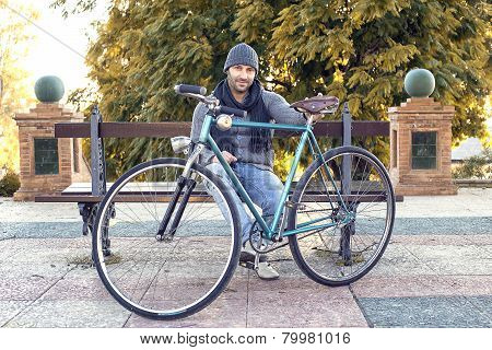 Young Man With Old Bicycle