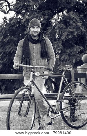 Young Man With Old Bicycle In Black And White