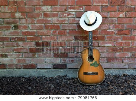 Musician Takes A Break - Guitar, Harp And Panama Hat