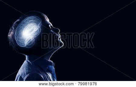 Young thoughtful boy of school age with closed eyes