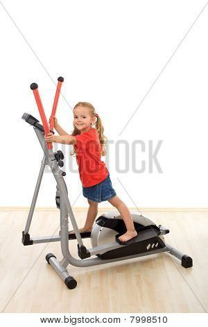 Little Girl On Elliptical Trainer
