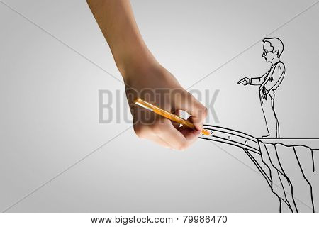 Human hand drawing caricature of man and bridge above gap