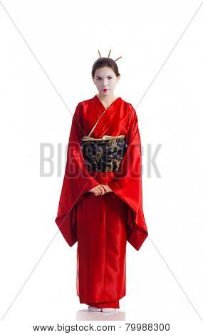 The girl in native costume of japanese geisha, isolated on white
