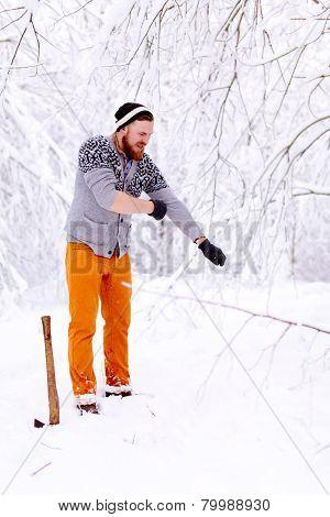 Lumberjack is preparing to cut trees