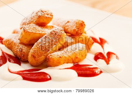 dessert from cottage cheese with sauce