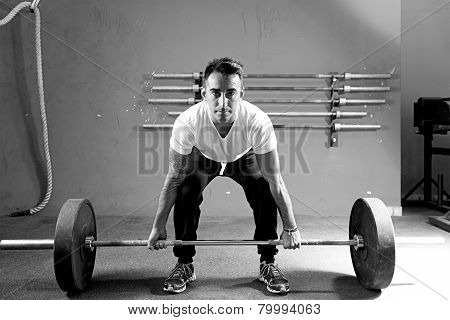 Young Man On A Weightlifting Session - Workout.