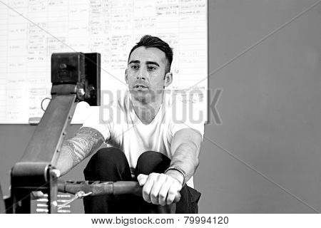 Young Man On Rowing Machine - Workout.